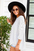 Model wearing White Oversized Striped Top Side View