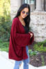 Model wearing Burgundy Oversized Ruffled Cardigan Side View