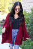Model wearing Burgundy Oversized Ruffled Cardigan