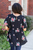 Model wearing Black Floral Embroidered Babydoll Top Back View