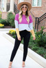 Model wearing Multi Color Ribbed Color Block Knit Top Tucked into Jeans