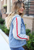 Model wearing Light Wash Denim Vested Hoodie with Side Stripe Side View