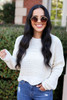 Model wearing Ivory Scalloped Chunky Knit Cropped Sweater Front View