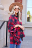 Model wearing Red Oversized Plaid Ruffle Sleeve Top Side View