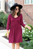 Model wearing Burgundy 3/4 Sleeve Babydoll Dress Front View
