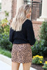 Model wearing Mocha Faux Suede Leopard Mini Skirt Back View