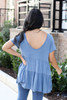 Model wearing Denim Tiered Babydoll Top Back View