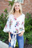 White - Model wearing the Erin Floral Tie-Front Blouse front view