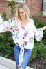 Model wearing the Erin Floral Tie-Front Blouse- second front view