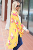 Mustard - Model wearing the Dacey Floral Ruffle Sleeve Kimono in Side view
