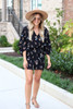 Model wearing Black Fall Floral Romper from Dress Up Full View