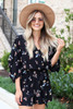 Model wearing Black Fall Floral Romper from Dress Up Front View
