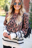 Dress Up Model wearing Leopard + Striped Color Block Sweater Detail View