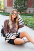 Rust - Leopard + Striped Color Block Sweater Sitting View