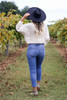 Dress Up Model at Chateau Elan wearing Medium wash Stretch Fit Mom Jeans Back View