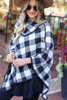 Model wearing White and Black Buffalo Plaid Fold Over Button Up Poncho Side View