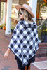 Model wearing White and Black Buffalo Plaid Fold Over Button Up Poncho Back View