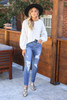 Dress Up Model wearing Medium Wash Distressed Stretch Fit Mom Jeans