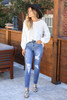 Dress Up Model wearing Medium Wash Distressed Stretch Fit Mom Jeans Front View