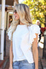 Dress Up Model wearing White Ruffle Sleeve Top Side View