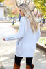 Model wearing the Denim Brushed Knit Pocketed Sweater from Dress Up - Back View