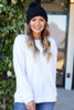 Dress Up Model wearing a white fuzzy sweater with black hat