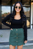 Dress Up Model wearing Olive Scalloped Hem Faux Suede Mini Skirt Front View
