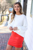 Red - red suede skirt paired with fuzzy white sweater