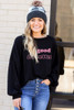Model wearing the Be Good Pullover with buffalo plaid beanie and jeans from Dress Up Front View