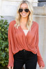 Model from Dress Up wearing the Drop Sleeve Surplice Top in Rust with Black Skinny Jeans and sunglasses Front View