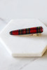 Flat Lay of Red Plaid Hair Big Clip on marble Side View