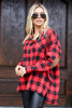 Model wearing the Red Buffalo Plaid Oversized Button Up Top with Faux Leather Leggings from Dress Up Side Front View