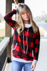Model wearing the Buffalo Plaid Hoodie from Dress Up