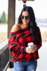 Model wearing the Red Buffalo Plaid Oversized Off the Shoulder Tunic with distressed jeans from Dress Up Front View