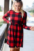 Red - Buffalo Plaid Babydoll Dress Model wearing the Buffalo Plaid Babydoll Dress in Red from Dress Up with over the knee boots Front View
