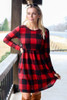 Model from Dress Up wearing the Buffalo Plaid Babydoll Dress in Red with over the knee boots Front View