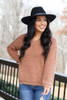 Model wearing the Camel Fuzzy Sherpa Sweater with high rise jeans and wide brim hat Front View