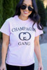 Model wearing the Champagne Gang Graphic Tee from Dress Up in Size Small Close Up View