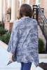 Model wearing the Grey Brushed Knit Cowl Neck Camo Poncho with high rise jeans from Dress Up Back View