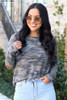 Model wearing the Elbow Patch Camo Top with high rise light wash jeans from Dress Up Boutique Close Up Front View