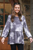 Dress Up model wearing the Tie-Dye Brushed Knit Oversized Babydoll Tunic with black skinny jeans