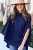 Model wearing the Brushed Knit Cowl Neck Oversized Poncho in Navy with medium wash jeans from Dress Up Front View