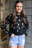 Model wearing the Leopard Luxe Knit Top with light wash denim shorts