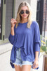 Blue - Model wearing the Blake Oversized Top with sunglasses