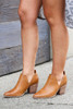 Camel - Model wearing the V-Cut Faux Leather Ankle Booties