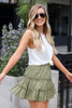 Model wearing the Eyelet Tiered Skirt in Olive with white tank top