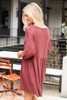 Model from Dress Up Boutique wearing the Button Front Babydoll Dress in Marsala with cute shoes Back View