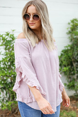 Model wearing Mauve Off the Shoulder Ruffle Sleeve Top Side View
