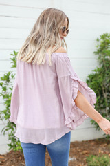 Model wearing Mauve Off the Shoulder Ruffle Sleeve Top Back View
