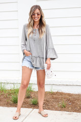 Model wearing Grey Ruffle Sleeve Acid Wash Top Full View